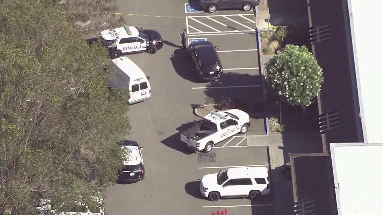 One newborn is dead and another is hospitalized after they were found behind a California building