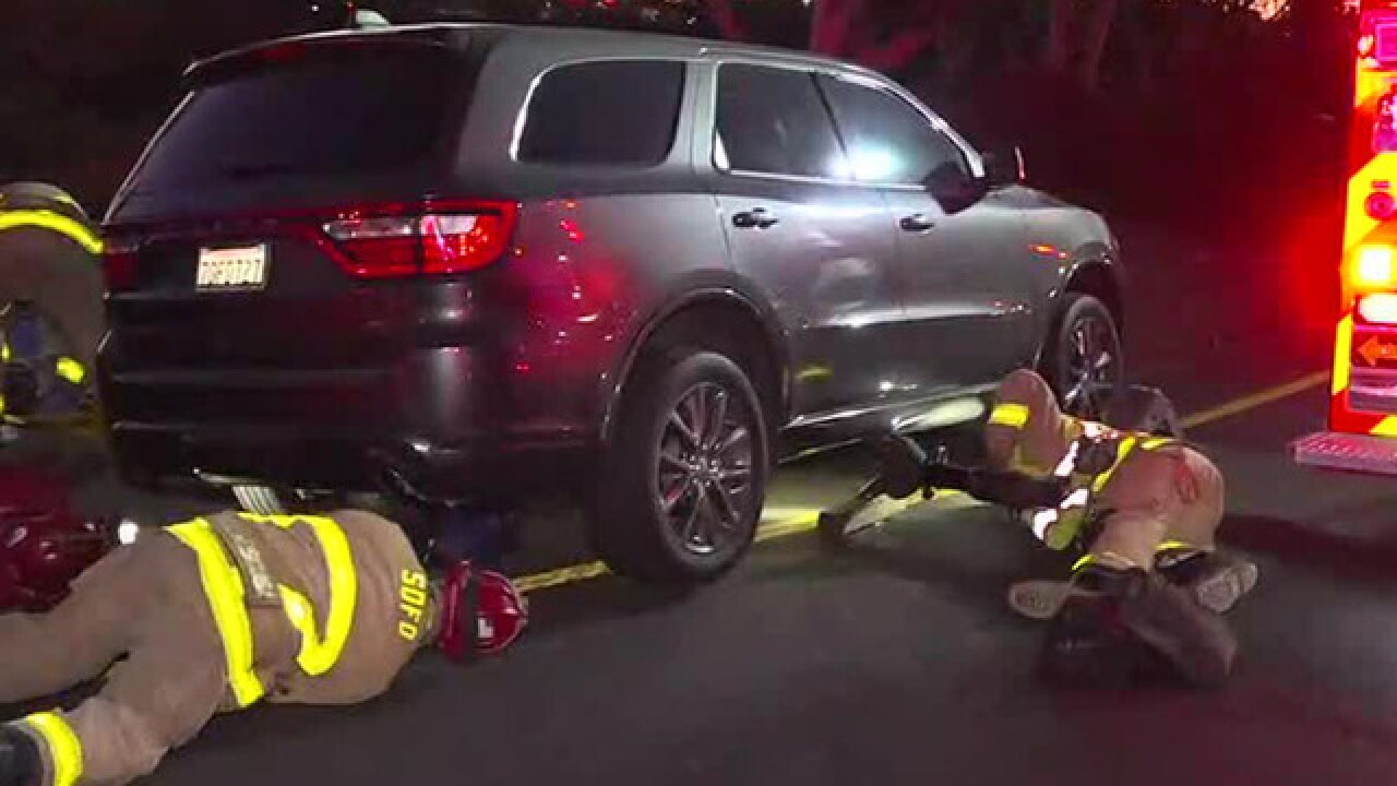 Woman hit by SUV, becomes trapped underneath