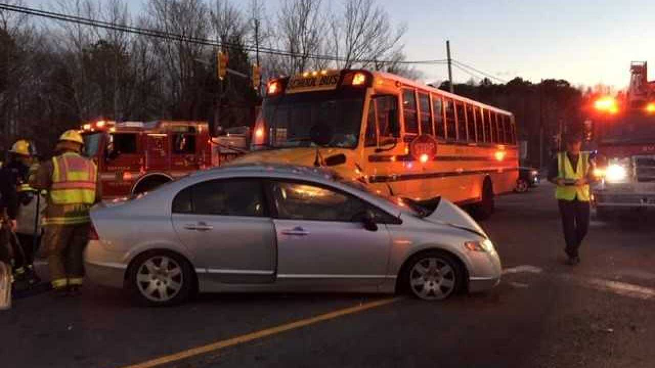 Police investigating two vehicle accident involving Suffolk school bus