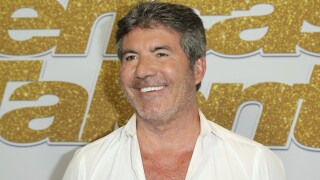 Simon Cowell has surgery for broken back after bike accident