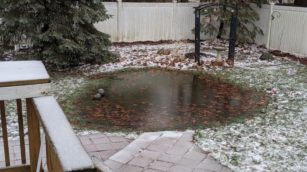 Flooded Yard in Wayland - Courtesy Heather Garrison via Facebook.jpg