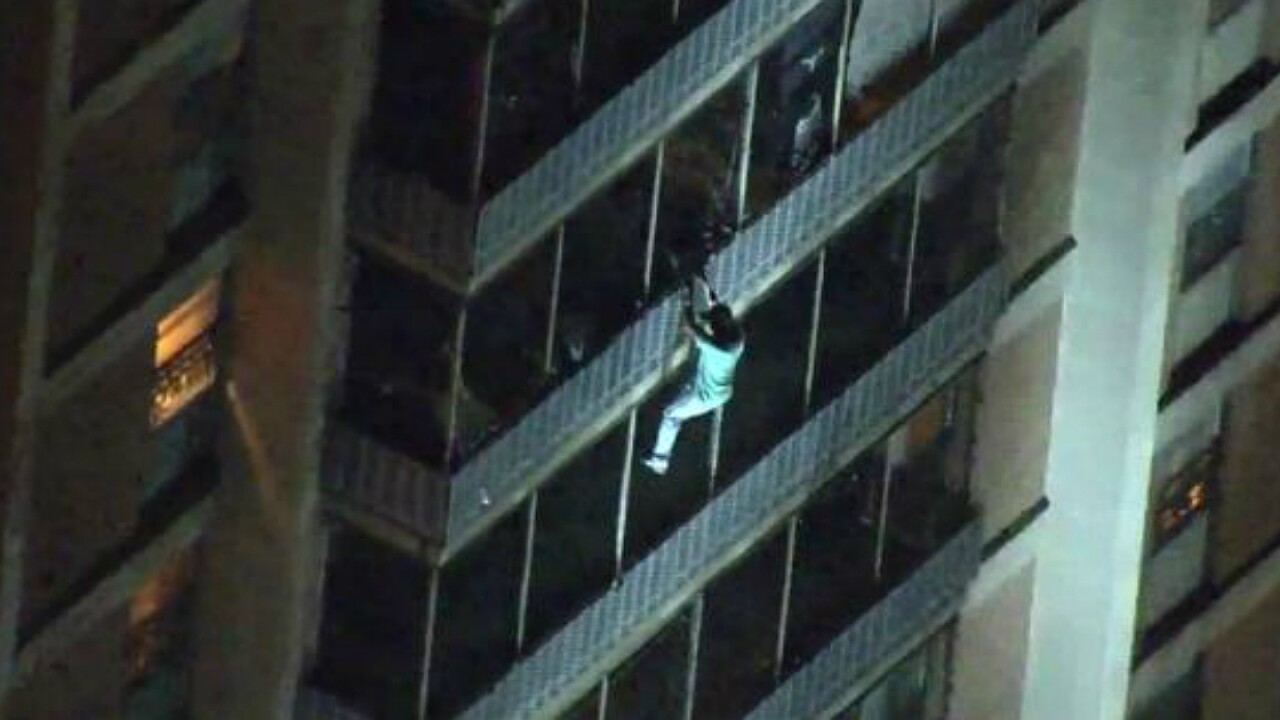Man escapes high-rise fire by climbing down 'Spider-Man' style