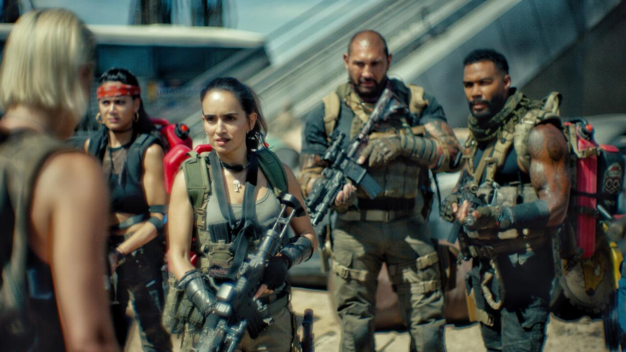 """It takes the Zack Snyder touch to make zombie flicks seem new again. """"Army of the Dead"""" eschews the recent comedic and ironic touches of the genre, barreling into the material as a straight-up action flick."""