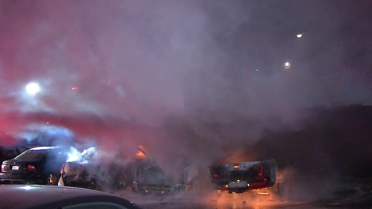 3 vehicles ablaze dangerously close to homes