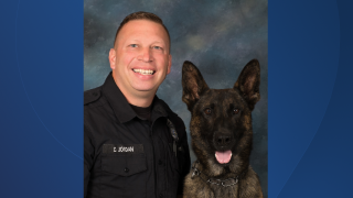 denny jordan, k9 officer and koda.png