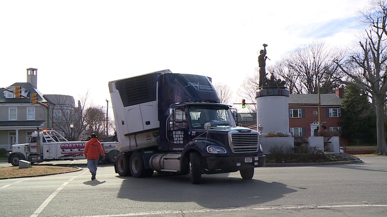 Trapped tractor-trailer damages Arthur Ashe statue base on Monument Avenue
