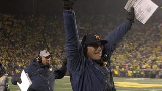 Jim harbaugh hands up