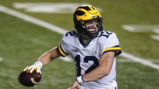 Michigan's Cade McNamara throws a pass during the second half of an NCAA college football game against Rutgers