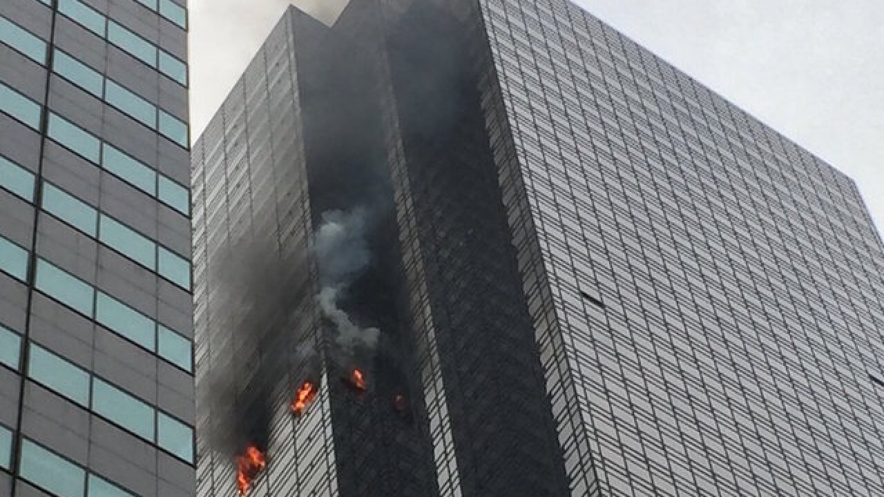 Fire at Trump Tower leaves man dead and 6 firefighters injured