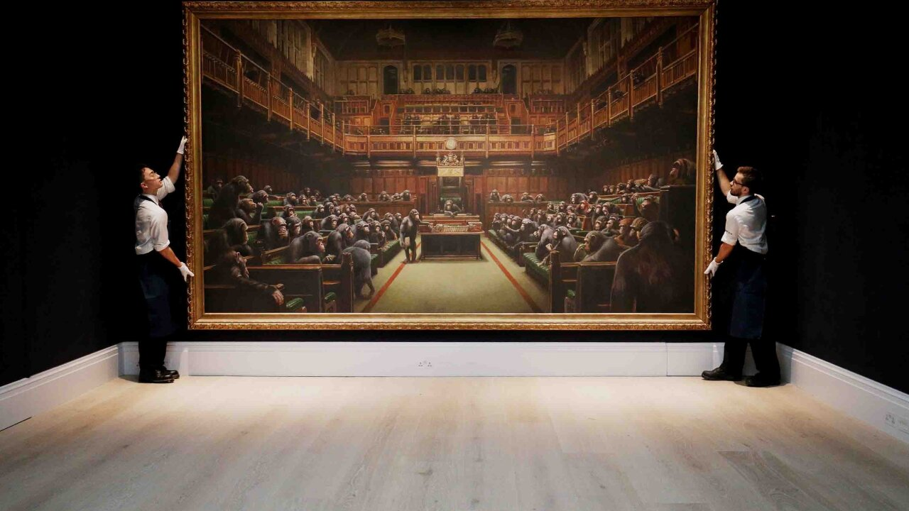 Banksy's 'Devolved Parliament' sells at auction for $12.2 million