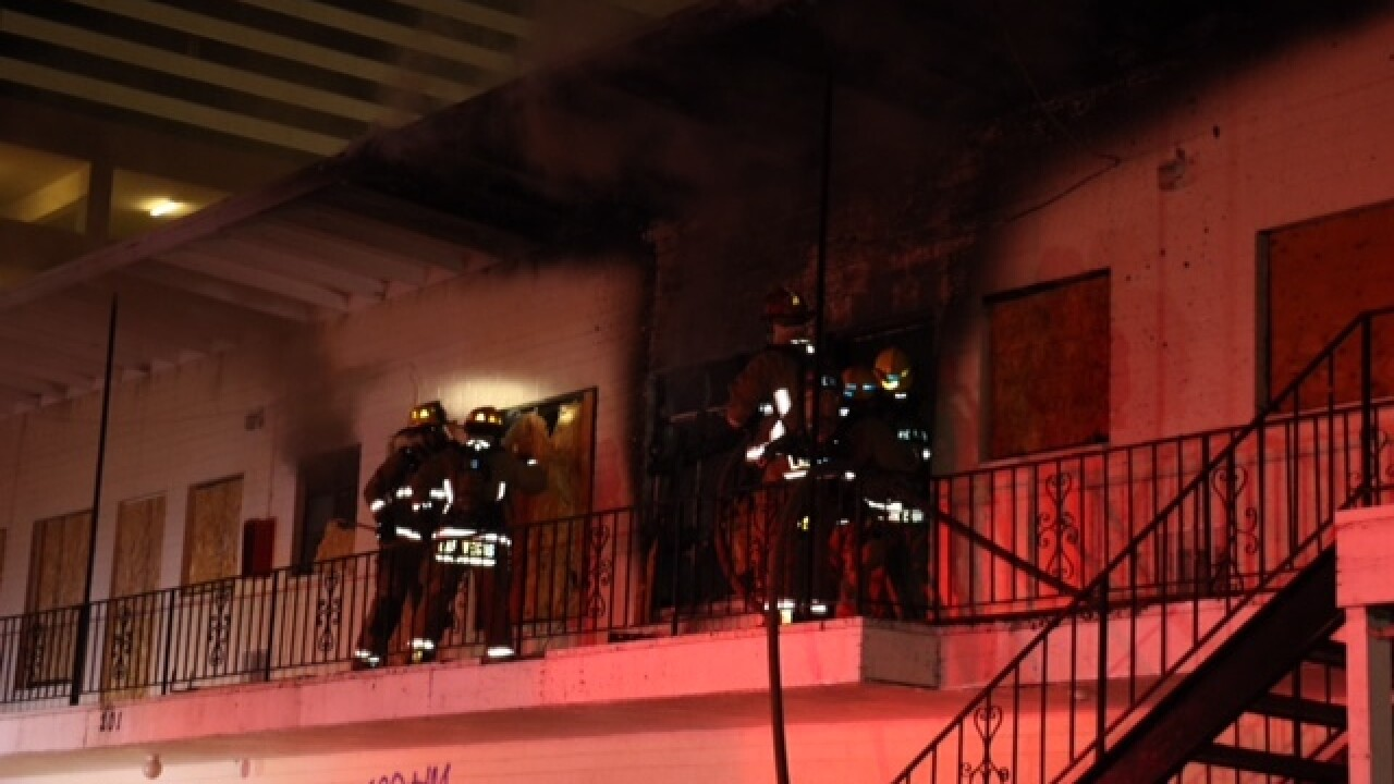 Squatters flee as vacant apartment catches fire
