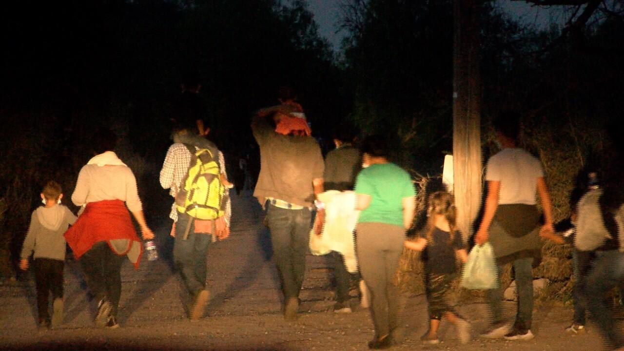 migrants walking at night.jpg