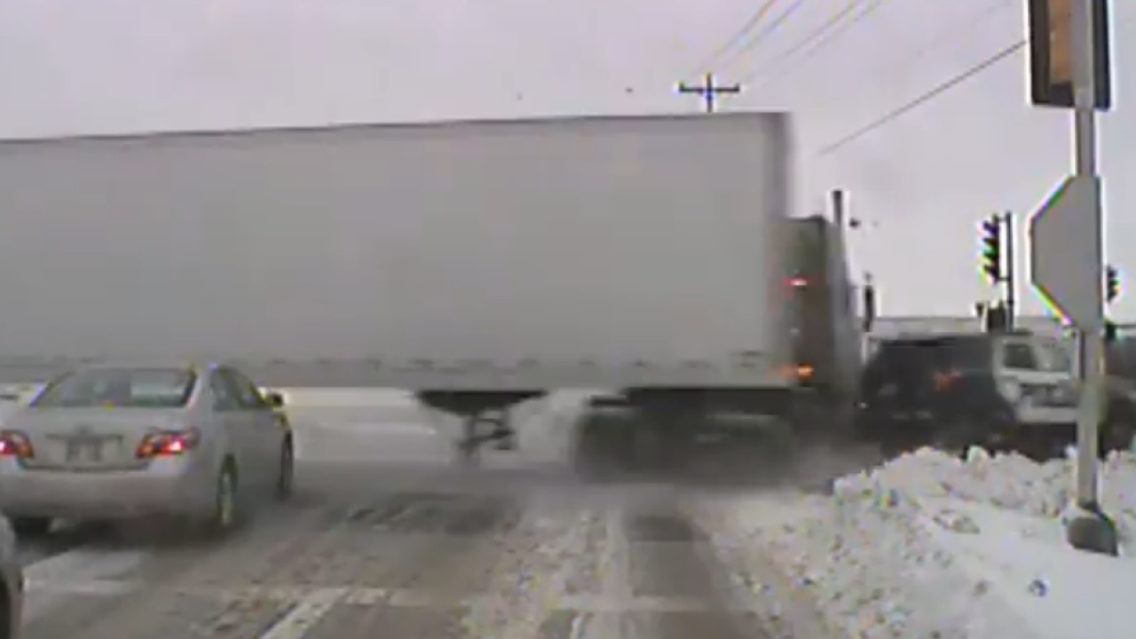 Semi-truck collides with Patrol Car.