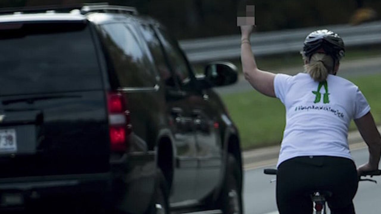 Woman who flipped off Trump says she was fired for it
