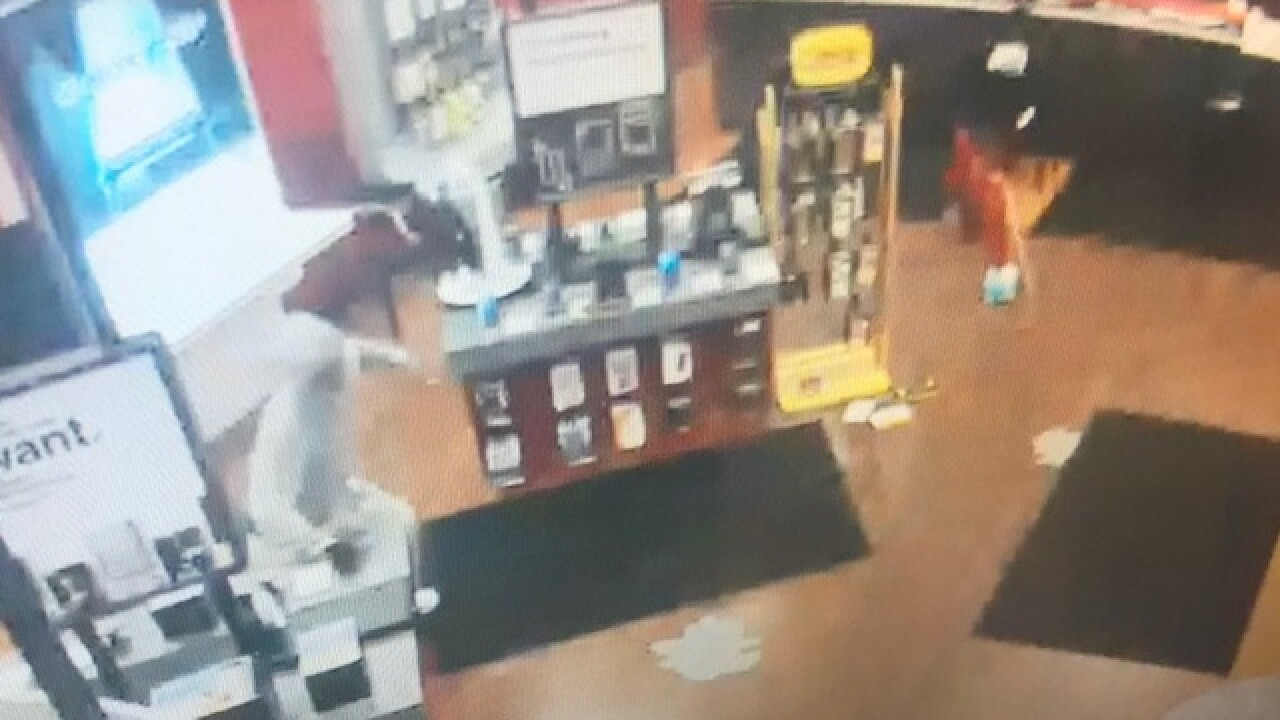 Surveillance images of cell phone store smash and grab suspects