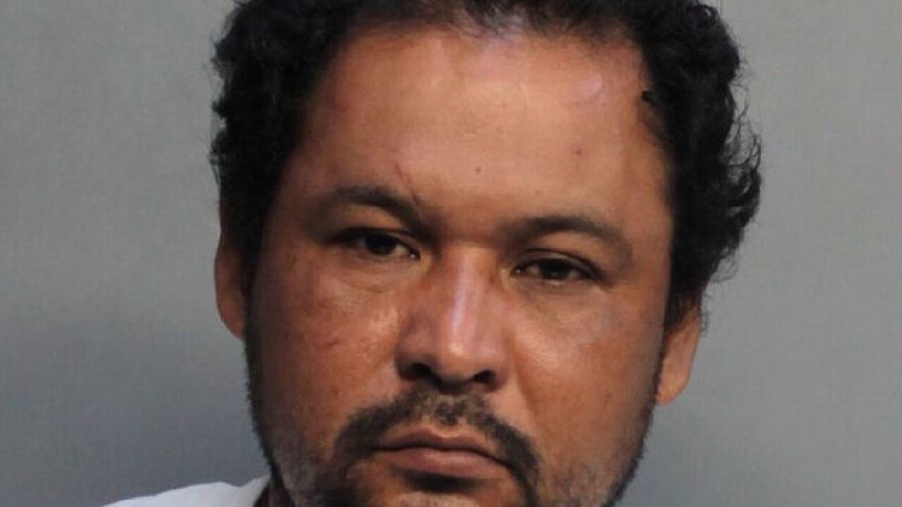 Miami man arrested after woman's body left on sidewalk