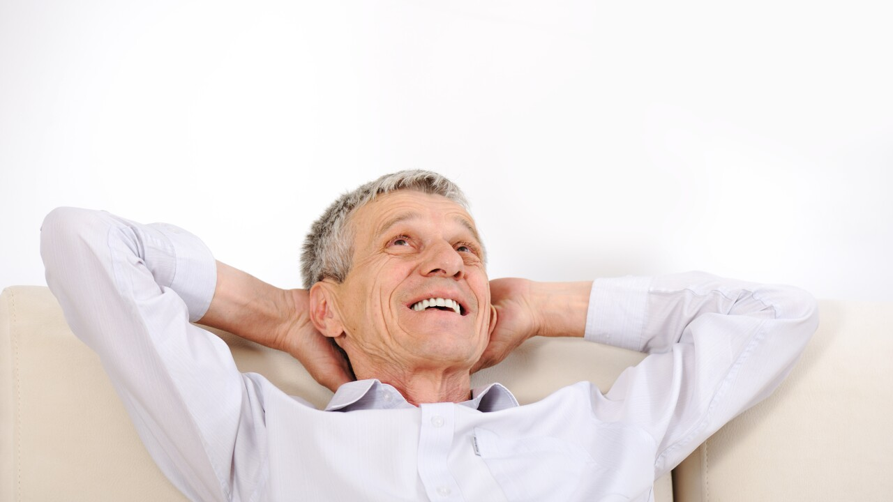 Happy relaxed elderly man at home couch napping resting content