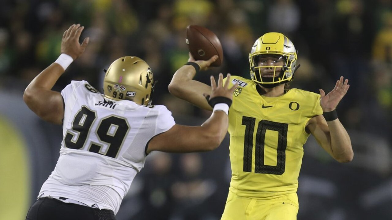 Herbert has 2 TDs in No. 13 Oregon's 45-3 win over Colorado