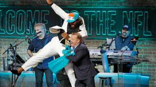 Christian Wilkins jump into NFL Commissioner Roger Goodell after he is drafted thirteenth overall by the Miami Dolphins on day 1 of the 2019 NFL Draft on April 25, 2019 in Nashville, Tennessee.