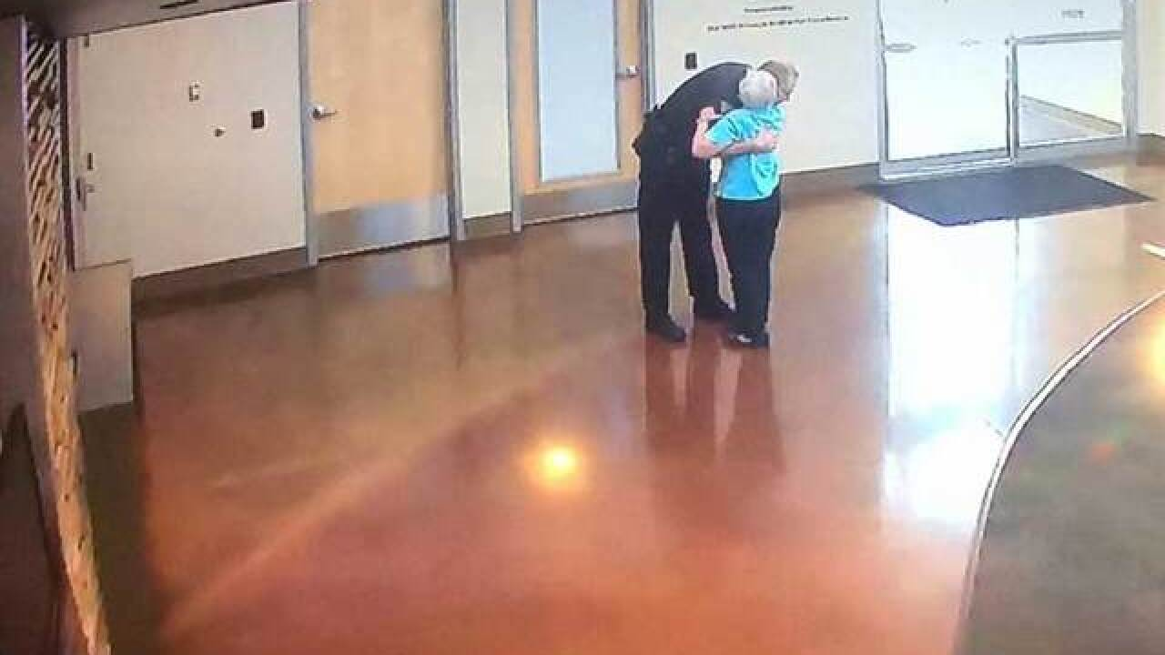 Woman visits Colorado PD station to hug officer