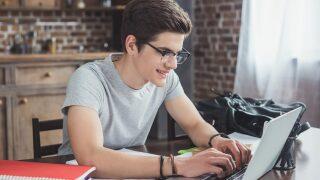 Man sitting at laptop computer