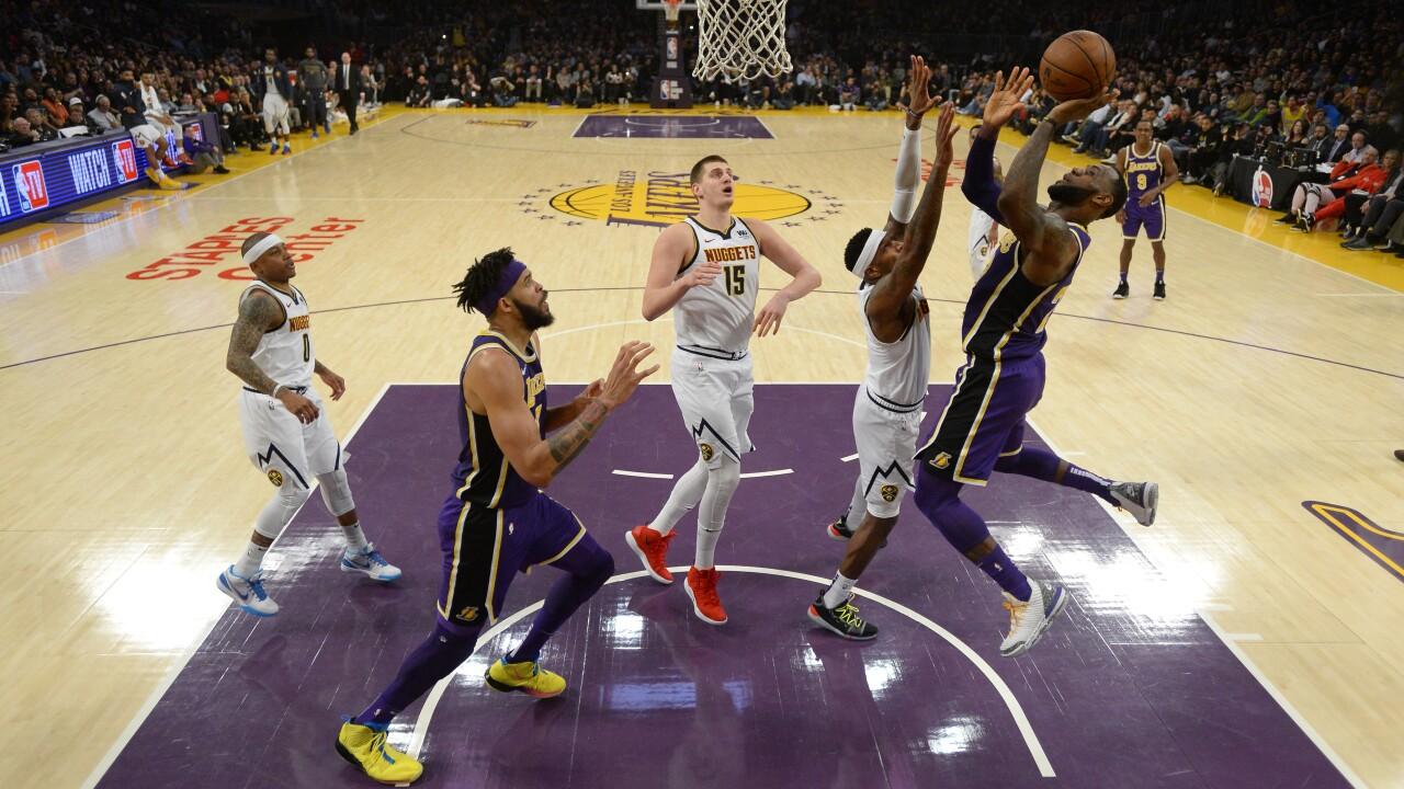 4f1c8ca25afa Nuggets top Lakers 115-99 as LeBron passes Jordan