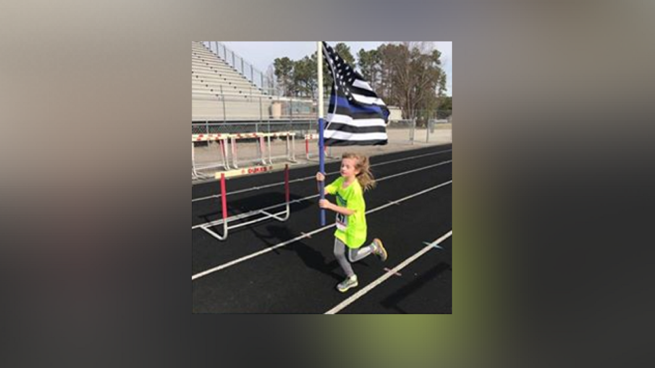 8-year-old runs in half marathon in support of wounded Portsmouth officer