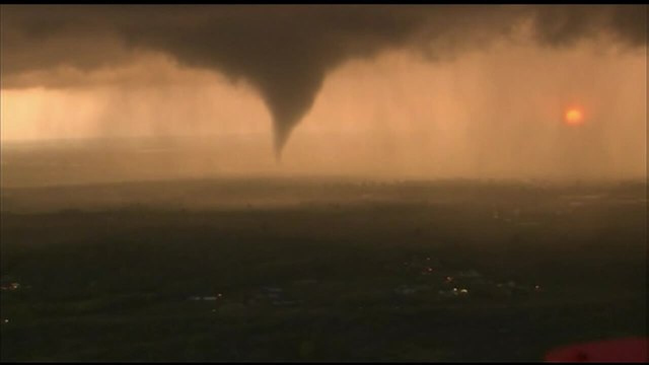 PHOTOS: Tornado forms, touches down