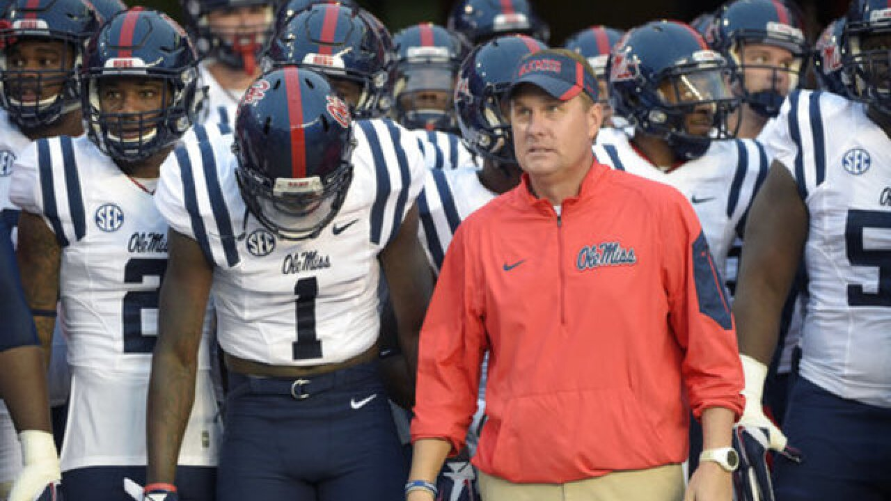 College football coach Freeze resigns at Ole Miss amid call service scandal
