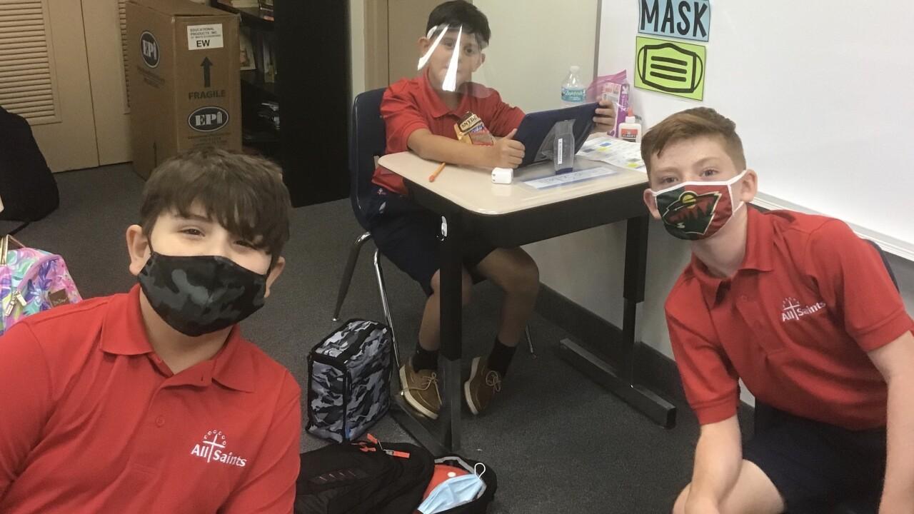 All Saints Catholic School students wearing masks in classroom