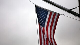 flags lowered for MI congressman
