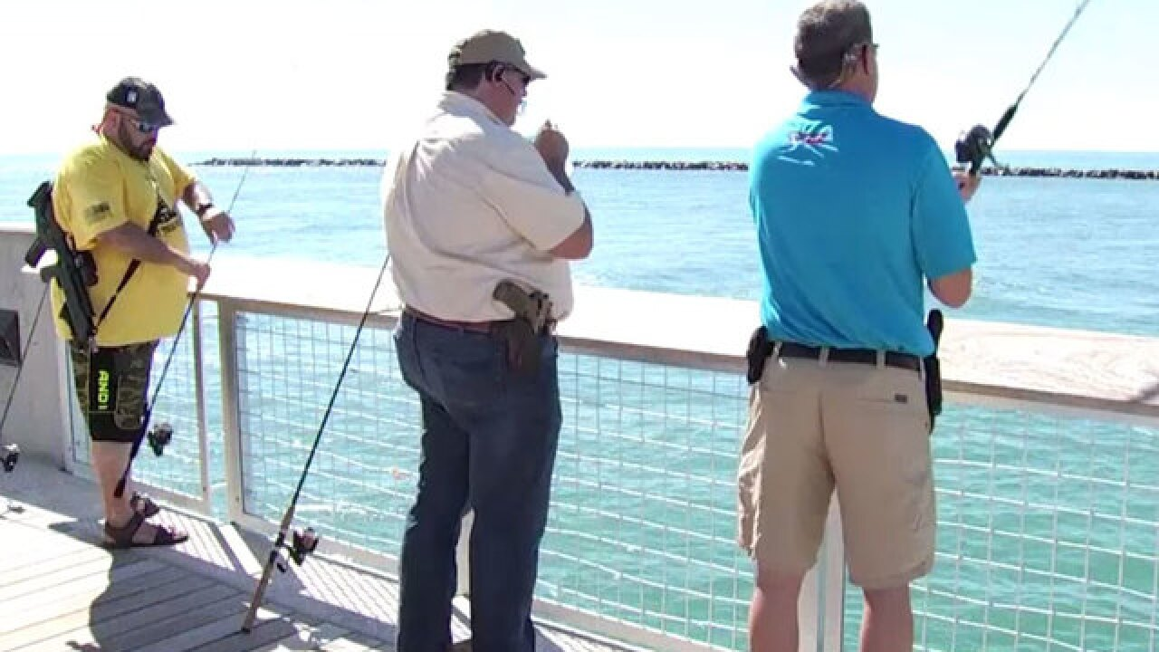 Group goes fishing with guns in Miami Beach to raise awareness about Florida open carry laws