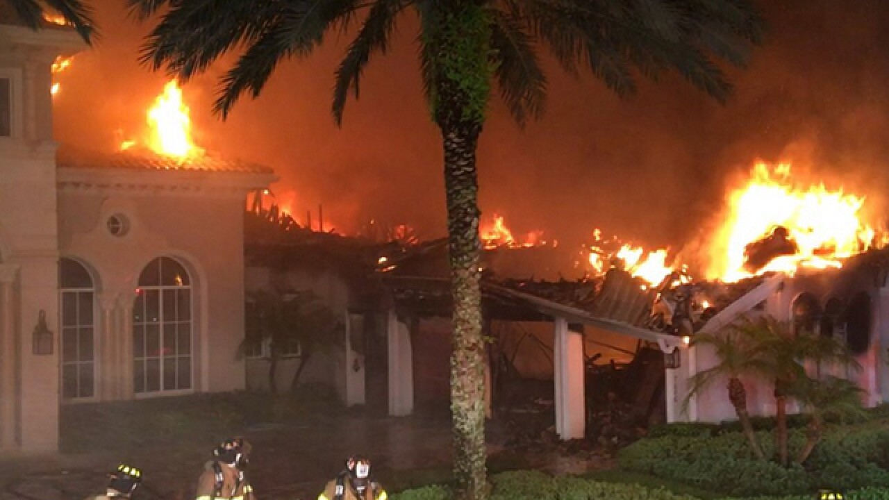 Large mansion gutted by fire in suburban Delray