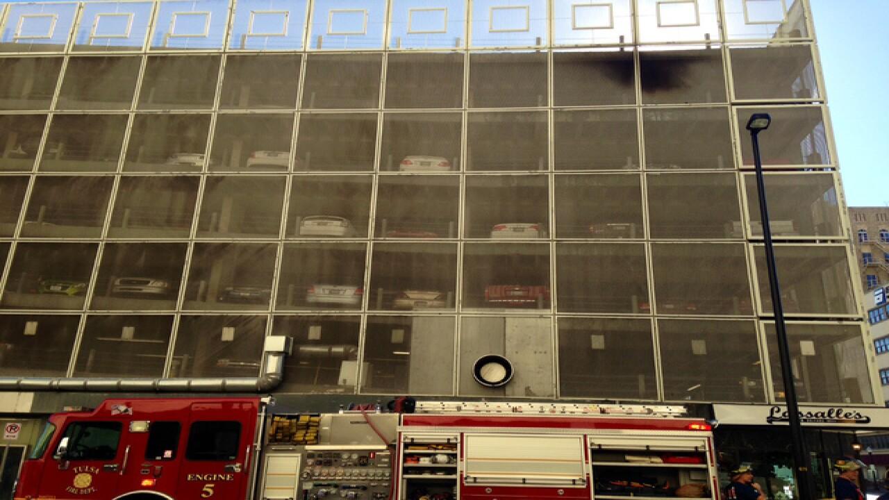 Vehicle fire in parking garage extinguished