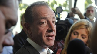 Michael Lohan, Lindsay Lohan's father, takes questions about his daughter after a hearing on May 20, 2010, in Beverly Hills, Calif..jpg