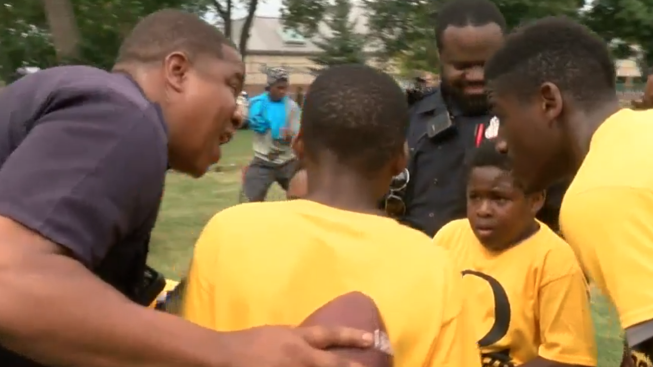 MPD officers playing football with youth in Sherman Park