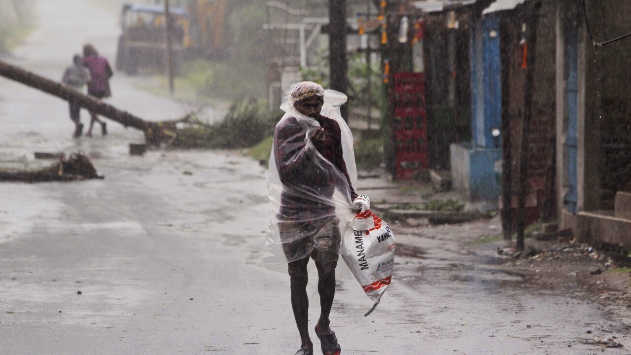 More than 80 dead after cyclone cuts destructive path in India, Bangladesh