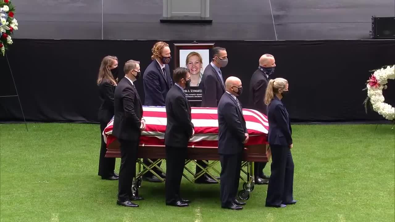FBI agents surround casket of Laura Schwartzenberger at Hard Rock Stadium memorial service, Feb. 6, 2021