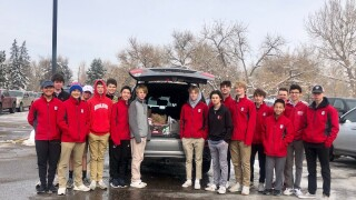 Regis Jesuit JV Hockey team food drive.jpg
