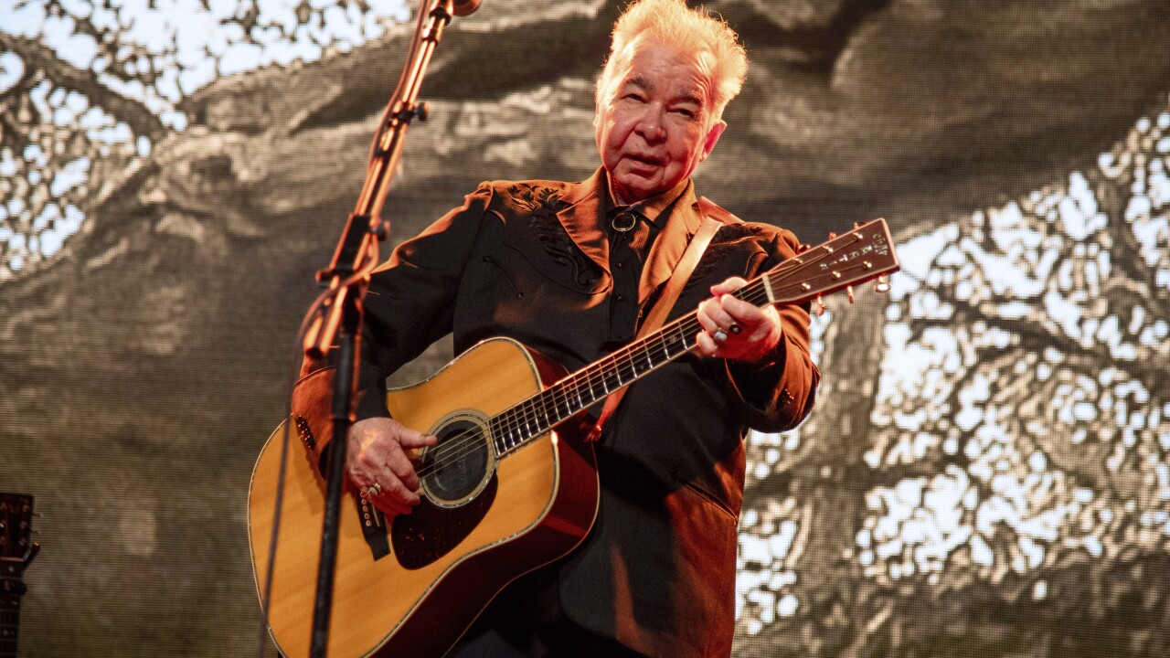 Singer John Prine is in stable condition, his wife says