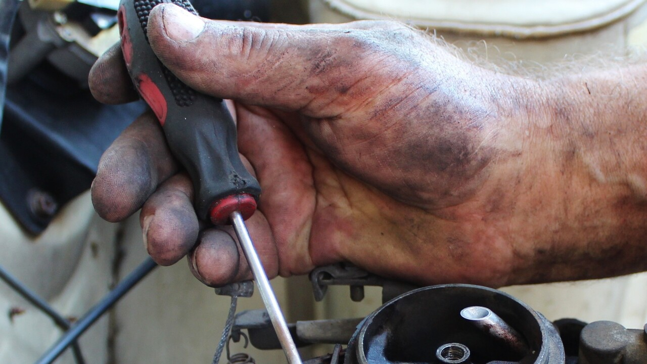 mechanic hands under the hood