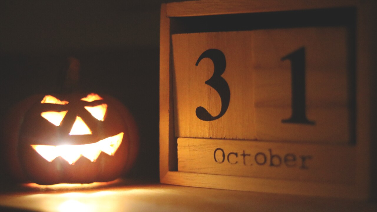 Canva - Halloween-themed Jack-o-lantern Lamp Near October 31 Calendar.jpg