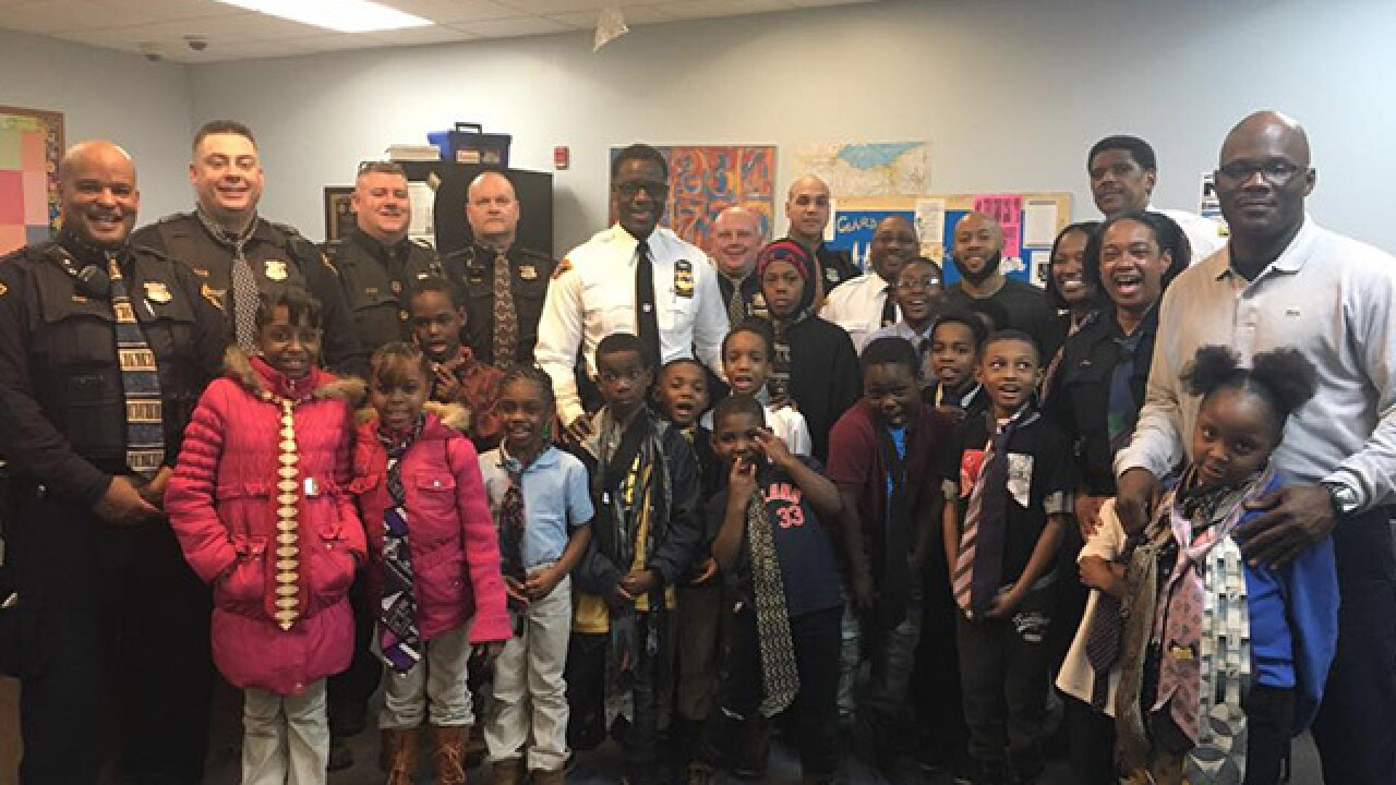 CLE police teach young boys how to tie ties