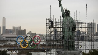 Photos: Olympic rings arrive in host city on barge into TokyoBay