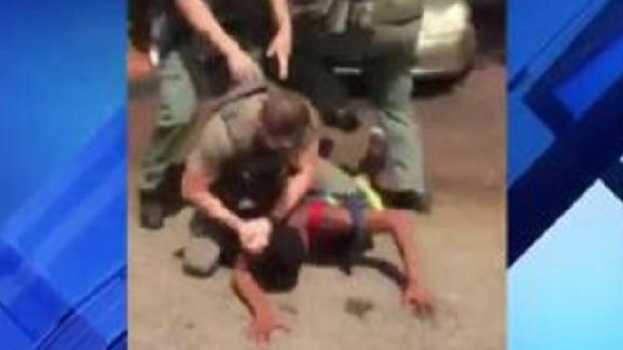 A Florida deputy is under investigation after viral video appears to show him slamming teen's head into the ground