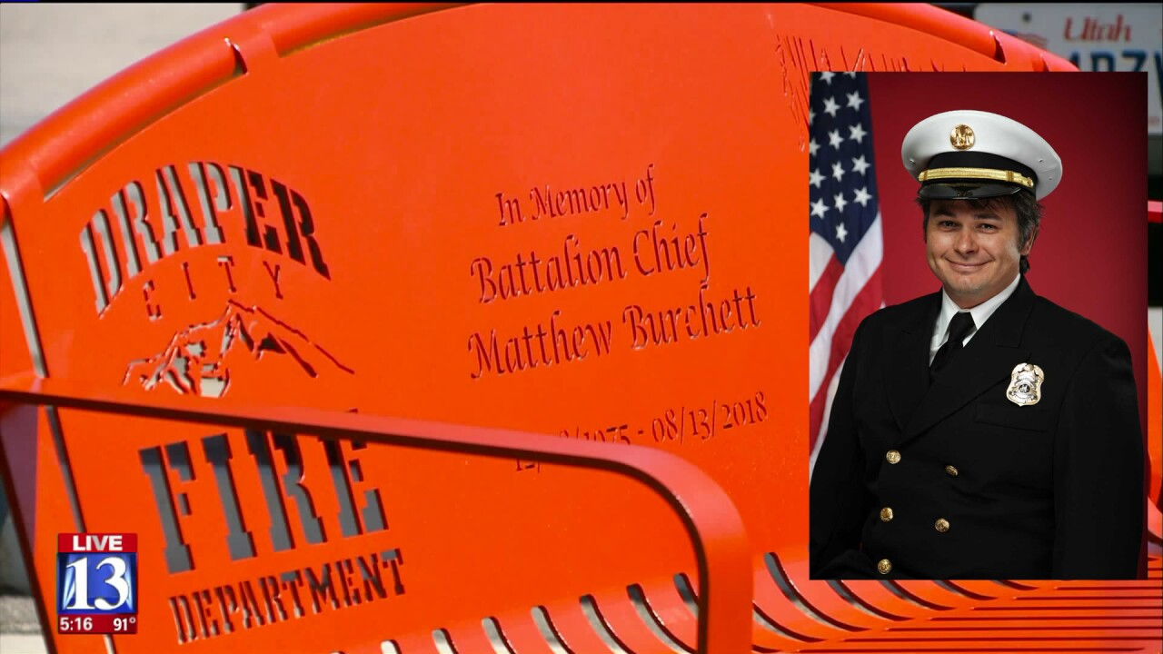 Bench honoring fallen fire chief in perfect place for grandfather andgrandson
