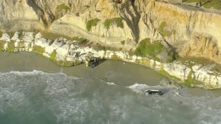 Man rescued after driving over bluff in Carlsbad