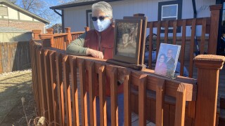 Irene Rael with pictures of her family