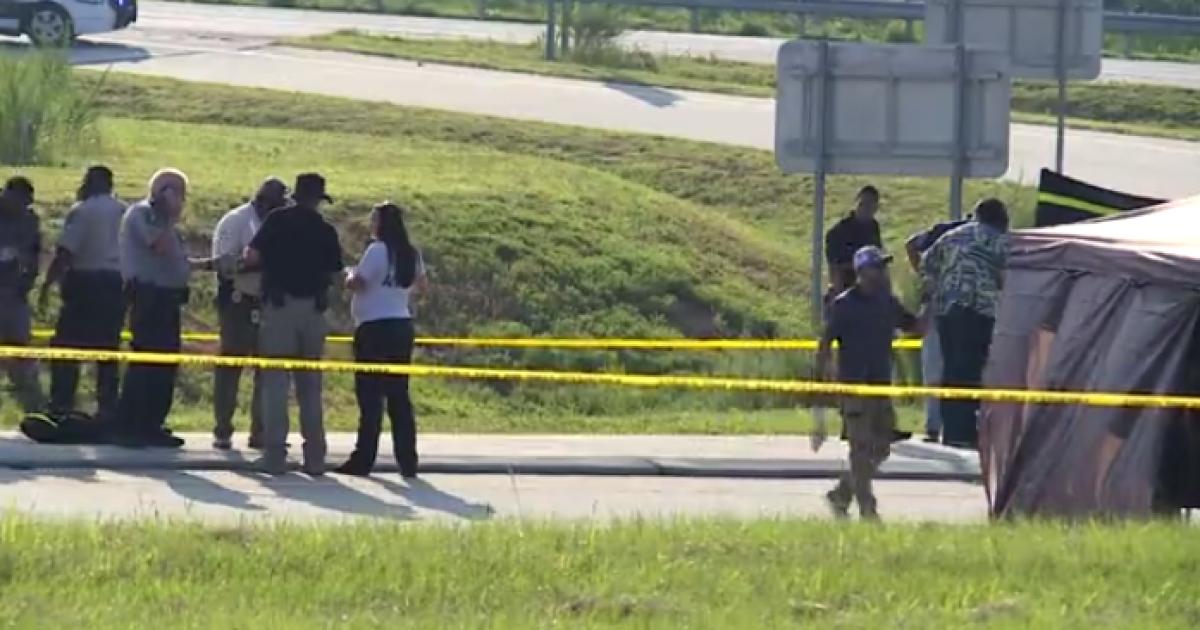 Man arrested after body found near interstate