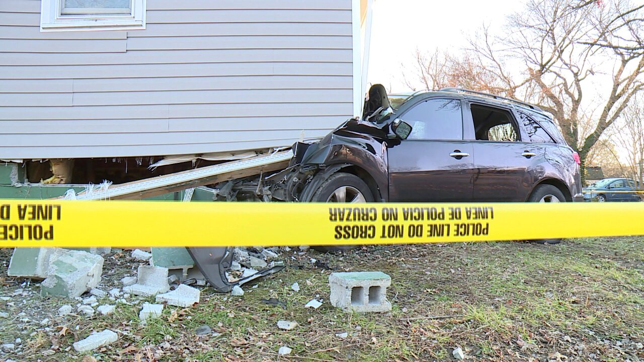SUV slams into Southside home